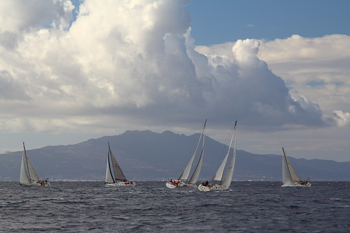 Bodrum,Turkey.10 December 2017: Sailboats sail in windy weather in the blue waters of the Aegean Sea, on the shores of the famous holiday destination Bodrum.