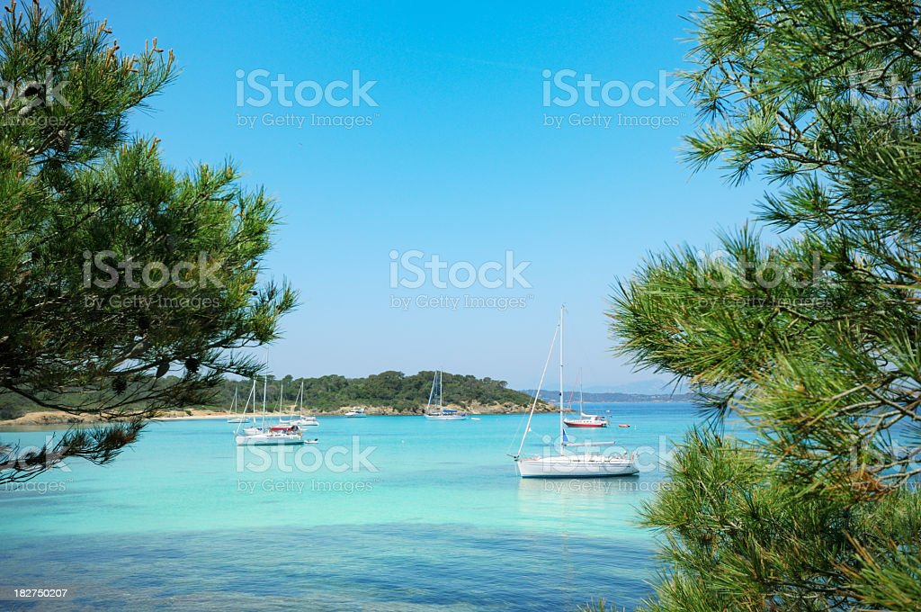 Sailboats sailing on clear water on French Riviera stock photo