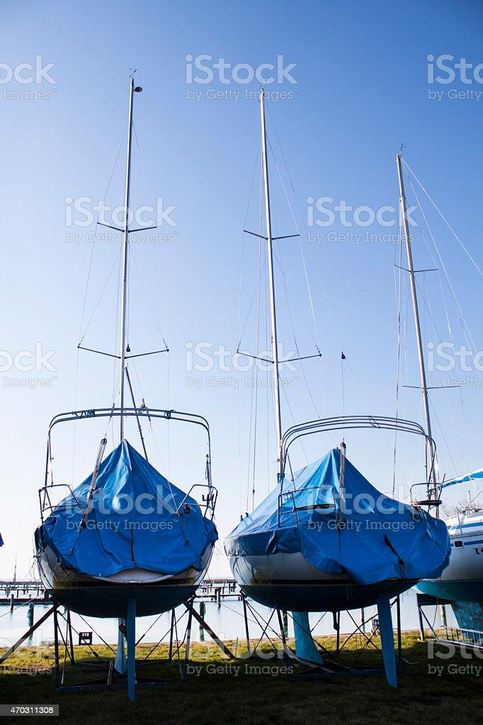 sailboats stored in a marina stock photo