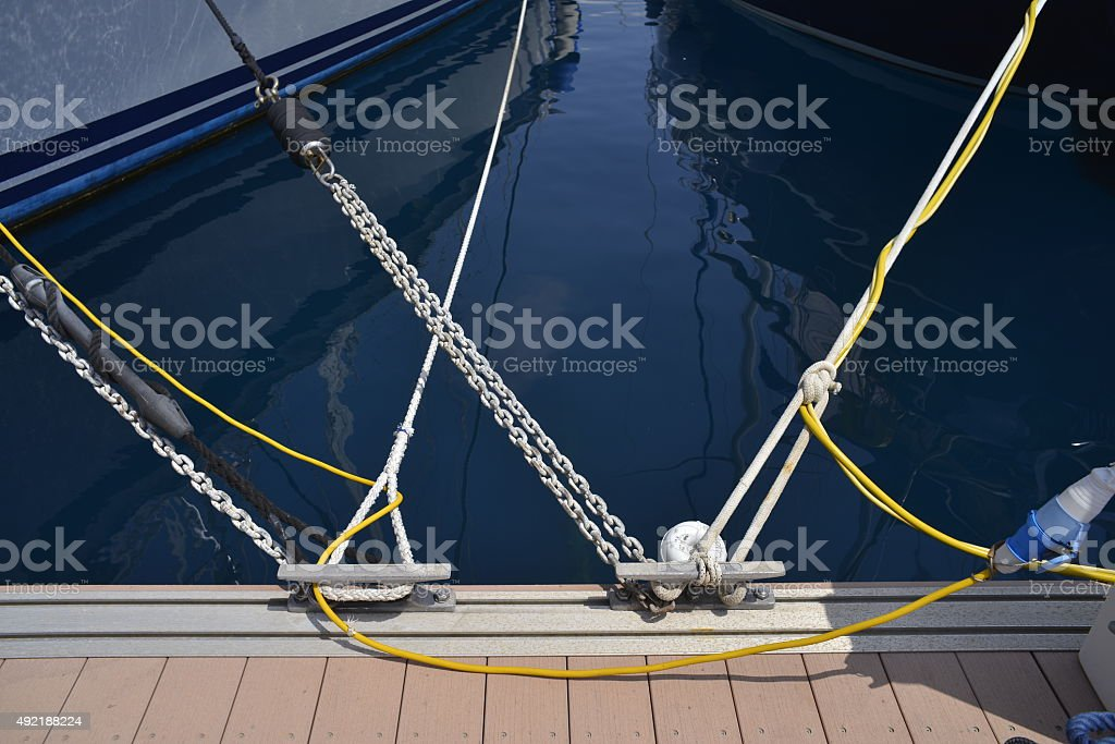 SailboatS tied up on a dock stock photo