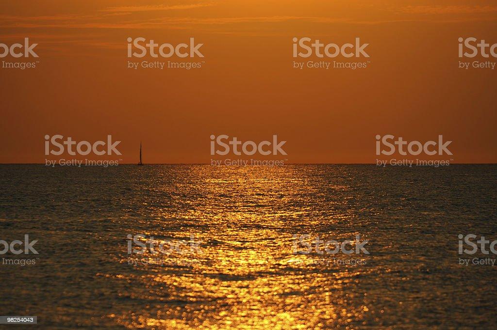 Sailin into the sunset royalty-free stock photo