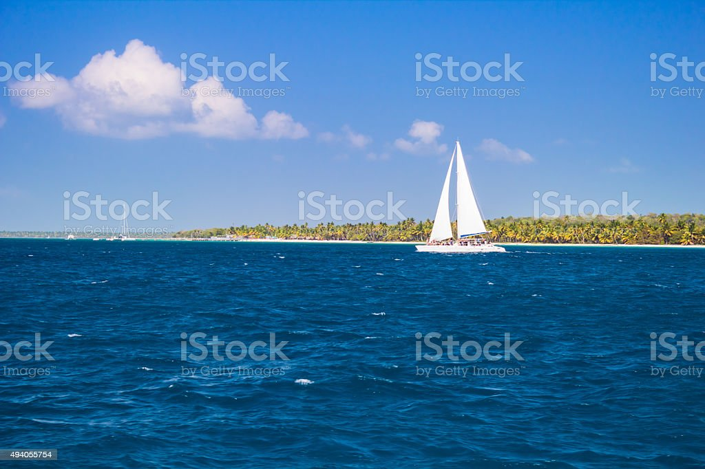 Sailing along caribbean wild beach stock photo