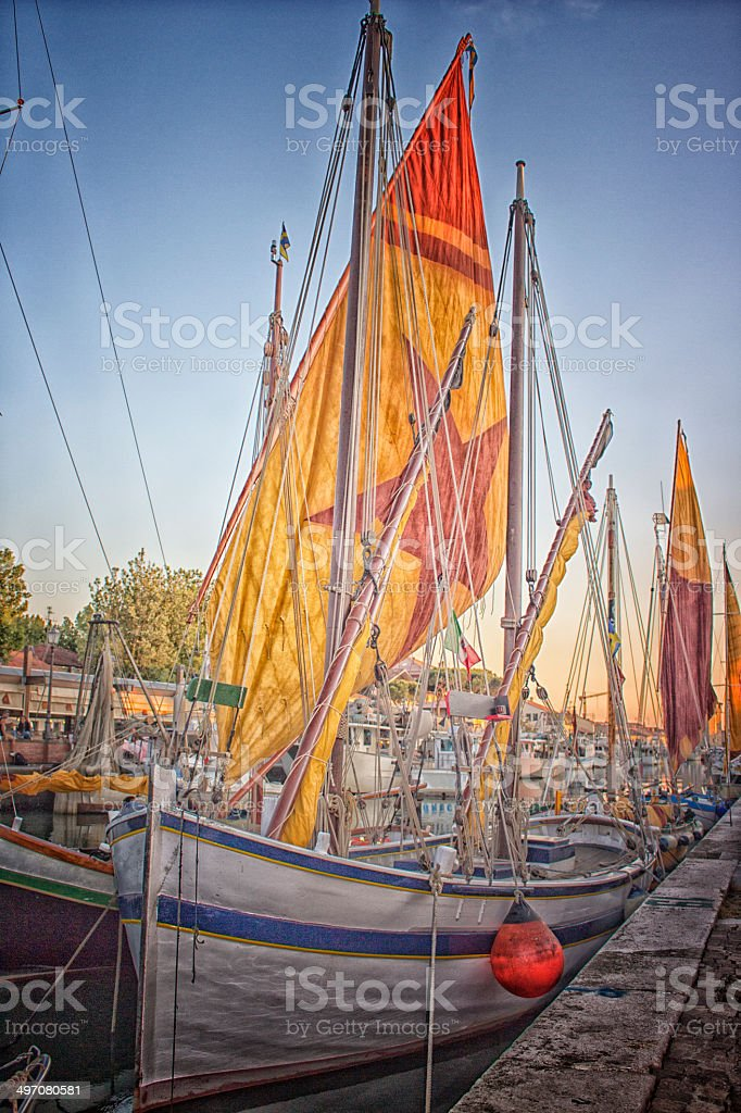 Sailing and engine boats in the harbour channel stock photo