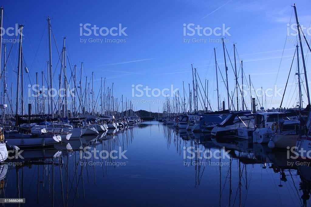 sailing and power boats moored in lymington marina stock photo