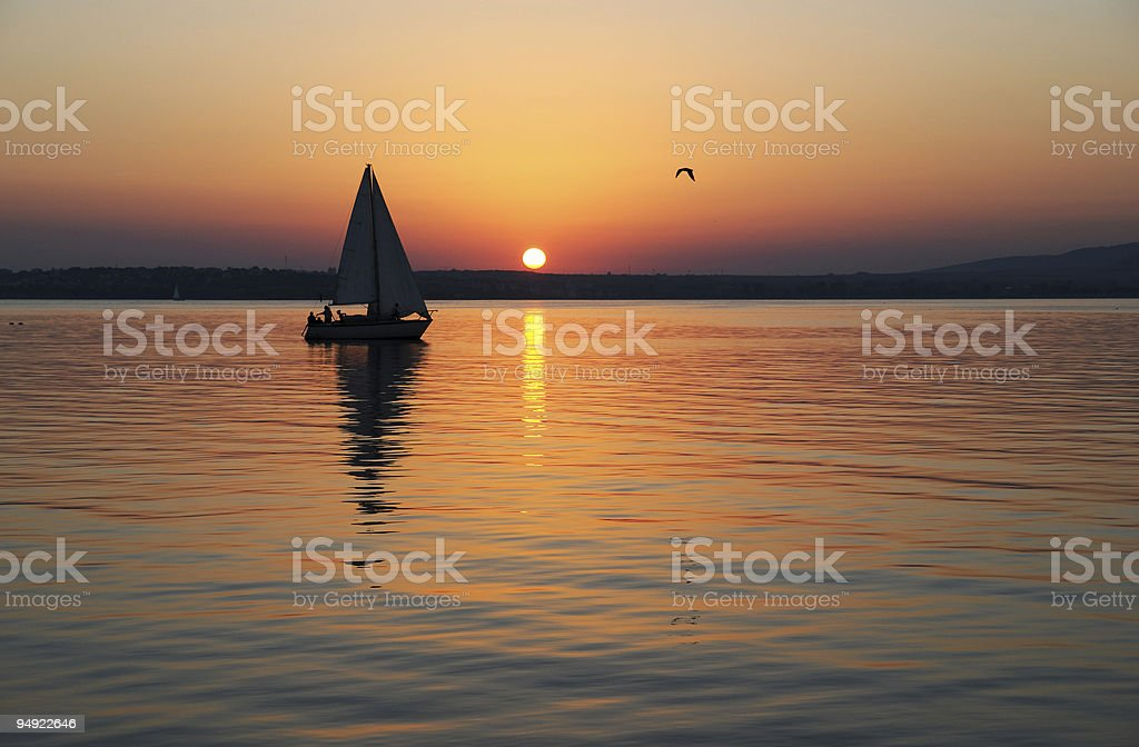 Sailing and sunset royalty-free stock photo
