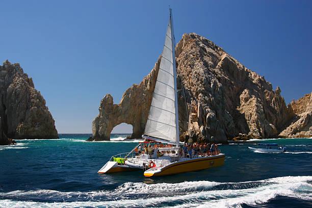 sailing at cabo san lucas arch - katamaran bildbanksfoton och bilder