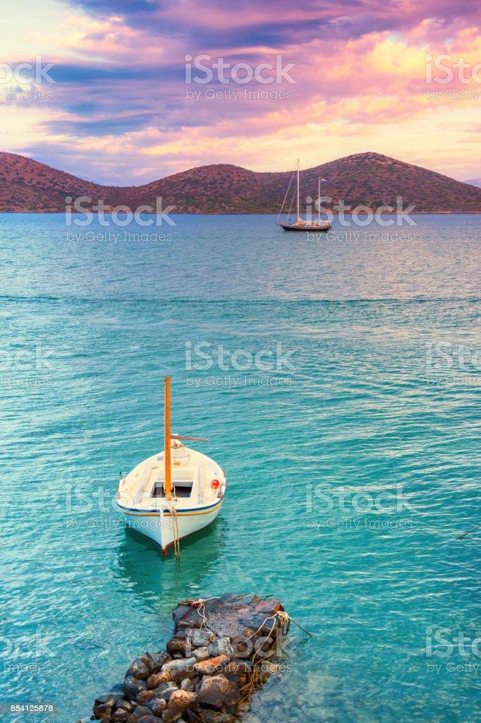 Sailing boat anchored in the peaceful gulf of Elounda, Crete. stock photo