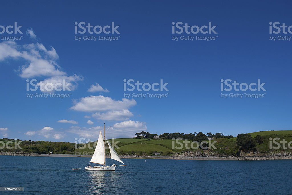 Sailing boat and Cornish Landscape stock photo