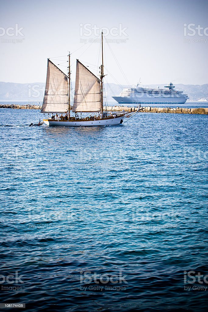 Sailing boat and cruise liner royalty-free stock photo