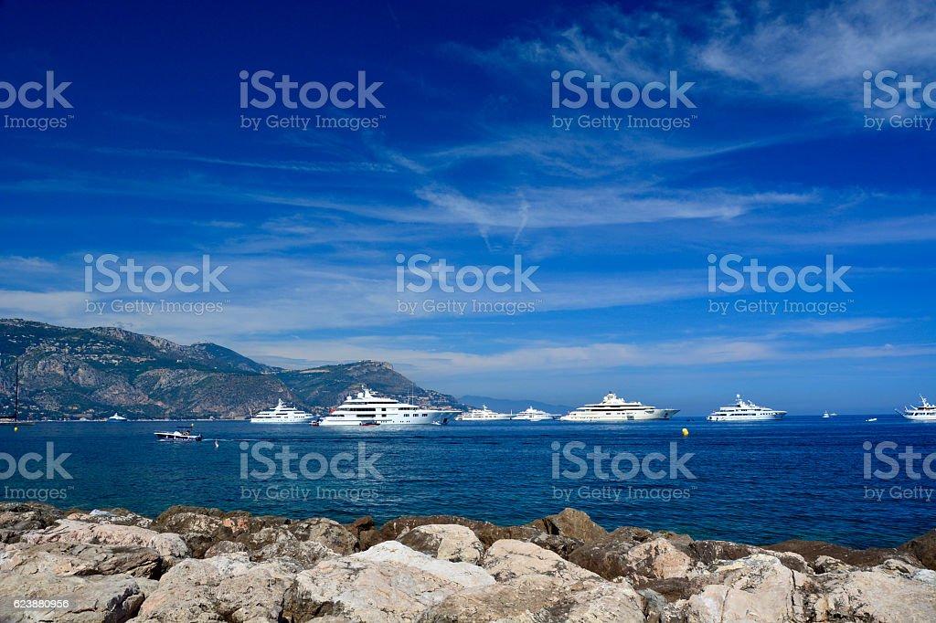 sailing boat and motor boat stock photo