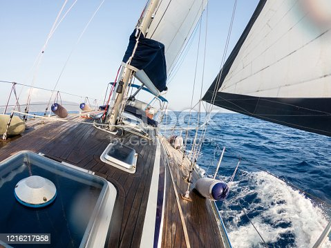 1011210354 istock photo Sailing boat at sea in summer in Tuscany, Italy 1216217958
