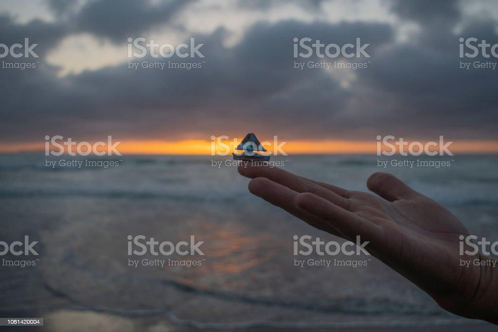 Sailing boat at Sunset in the Ocean with Clouds, velero navegando en el oceano al atardecer. stock photo