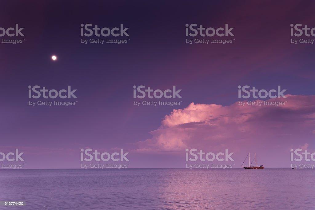 Sailing boat at the horizon stock photo