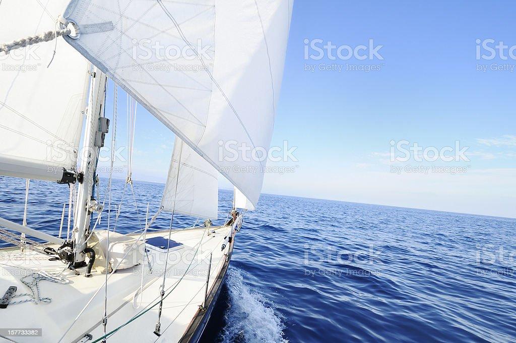 Sailing boat at the sea stock photo