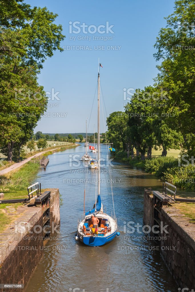 Sailing boat going out of a lock on the Gota canal in Sweden stock photo