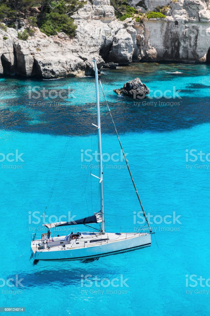 Sailing boat in a beautiful bay in Mediterranean sea stock photo