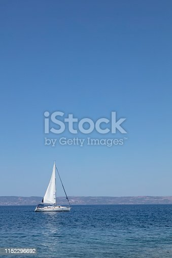 Sailing Boat in Beautiful Blue Aegean Sea  over Blue Sky and Mountains Lesbos Greece