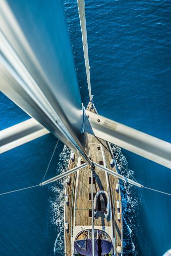 istock sailing boat in deep blue sea 1142921859