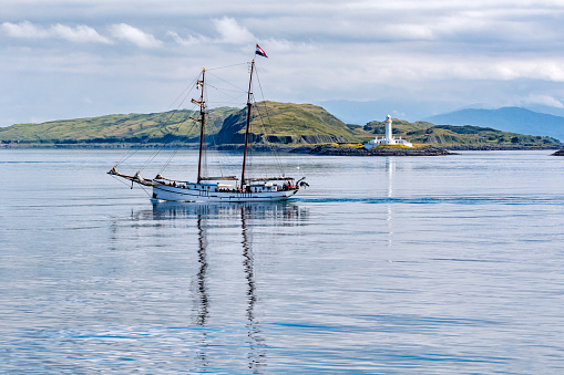 Sailing Boat In Front Of Eilean Musdile Lighthouse Stock Photo - Download Image Now