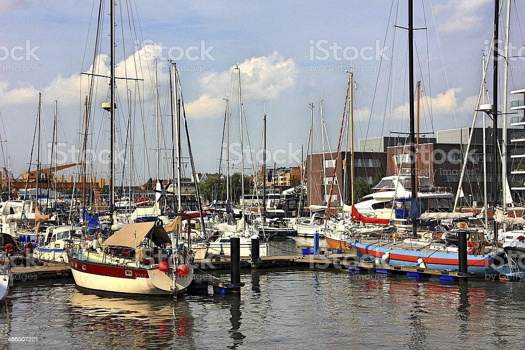 Sailing boat in the harbor stock photo