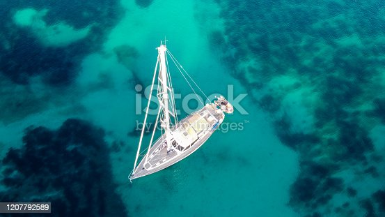 A cenital view of a sailing boat in the turquoise water of Majorca, balearic islands, spain