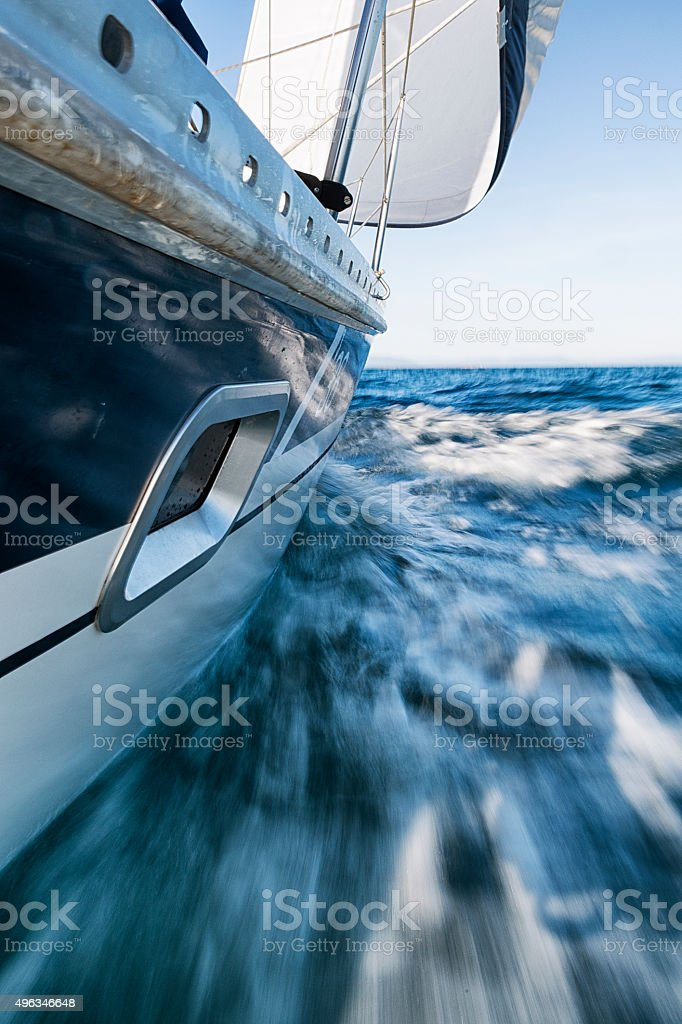 Sailing Boat Leaning, Low Wiewpoint, Motion Blurred stock photo