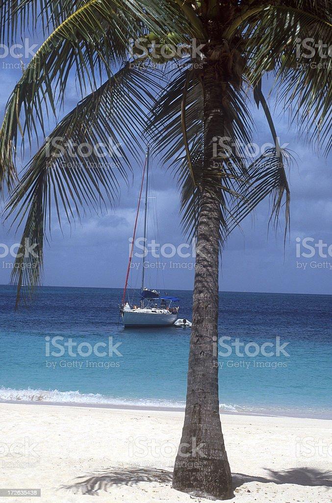 Sailing boat near a Caribbean beach royalty-free stock photo