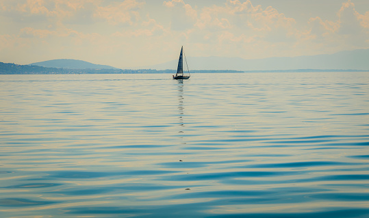 Sailing boat on a Swiss lake in summer
