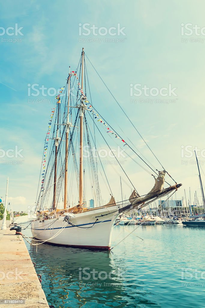 Sailing boat on Barcelona harbor stock photo