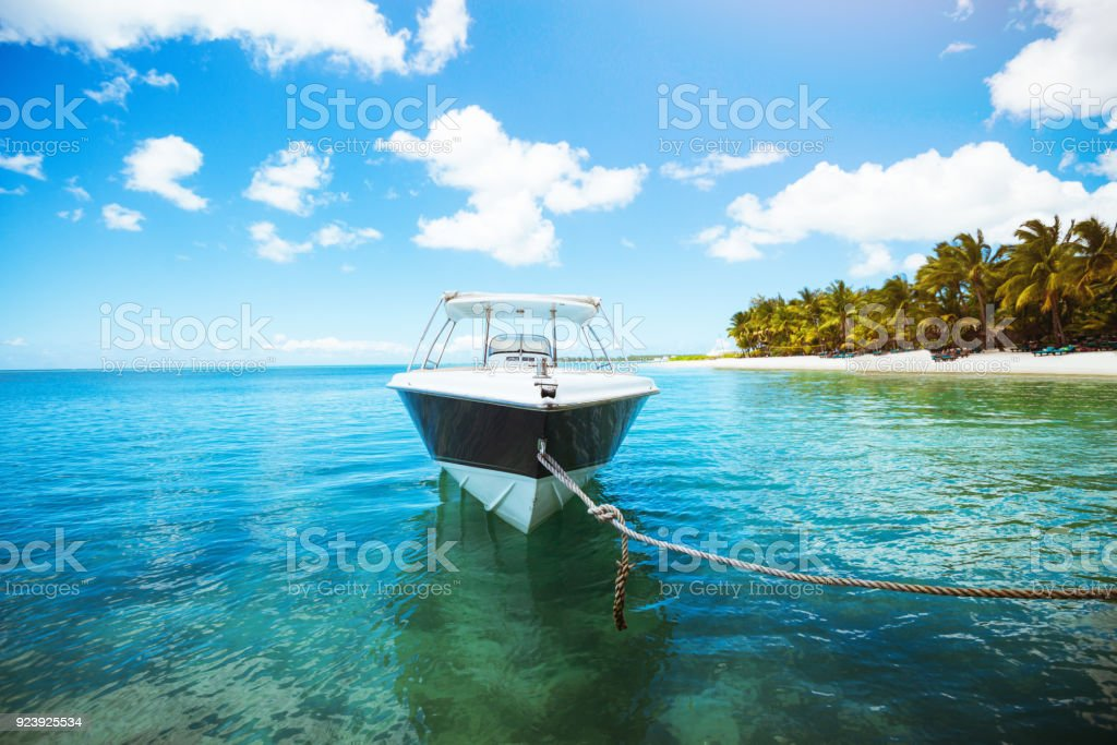 Sailing boat on crystal blue water of ocean. Tropical scene stock photo