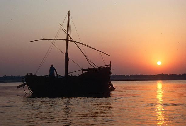 Sailing boat on Ganges River at sunrise stock photo
