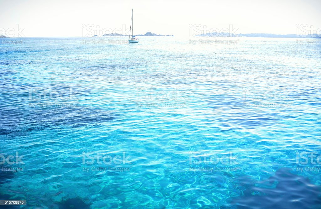 sailing boat on lonely sea stock photo
