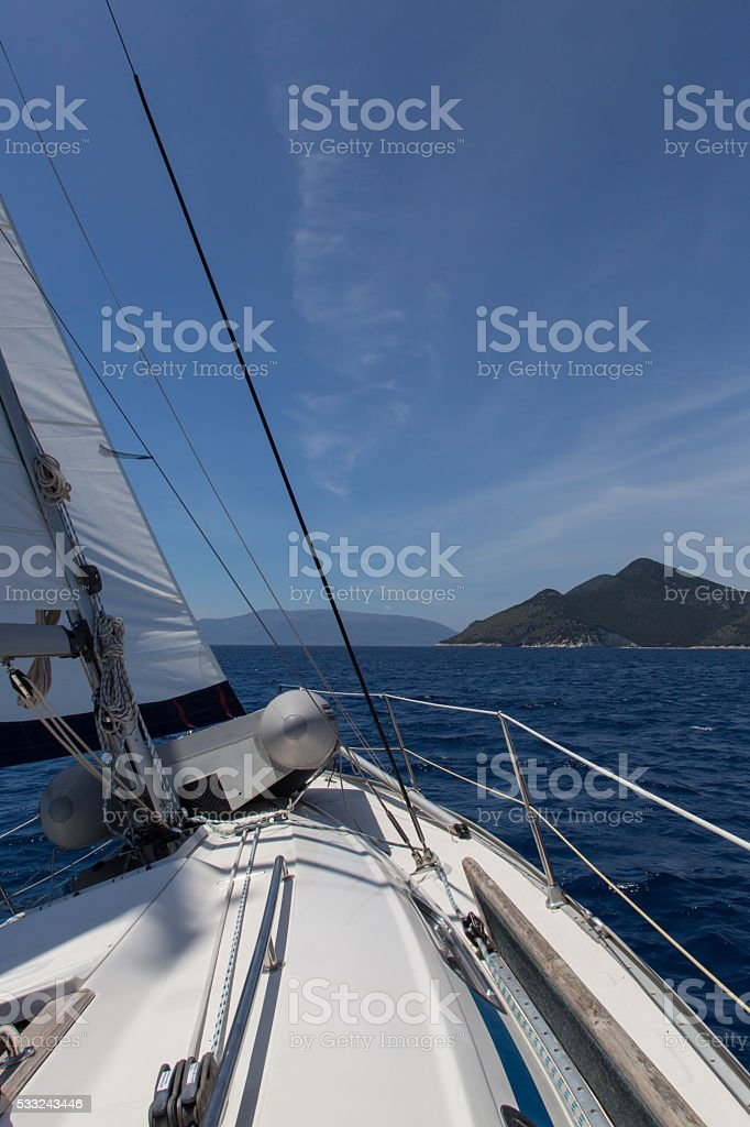 Sailing boat on sea with wind stock photo