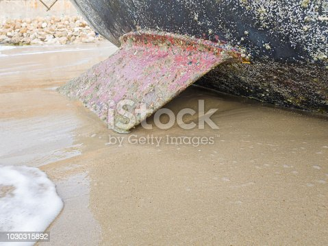 Sailing boat on the beach leans on the keel. Selective focus.