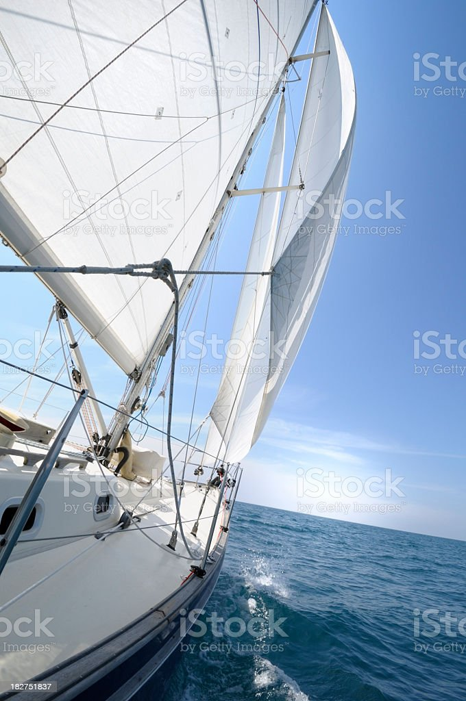 \'White sails of a yacht billowing in the wind, French Riviera\'