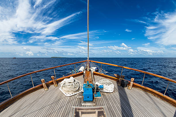 sailing boat on the ocean - yacht front view stock photos and pictures
