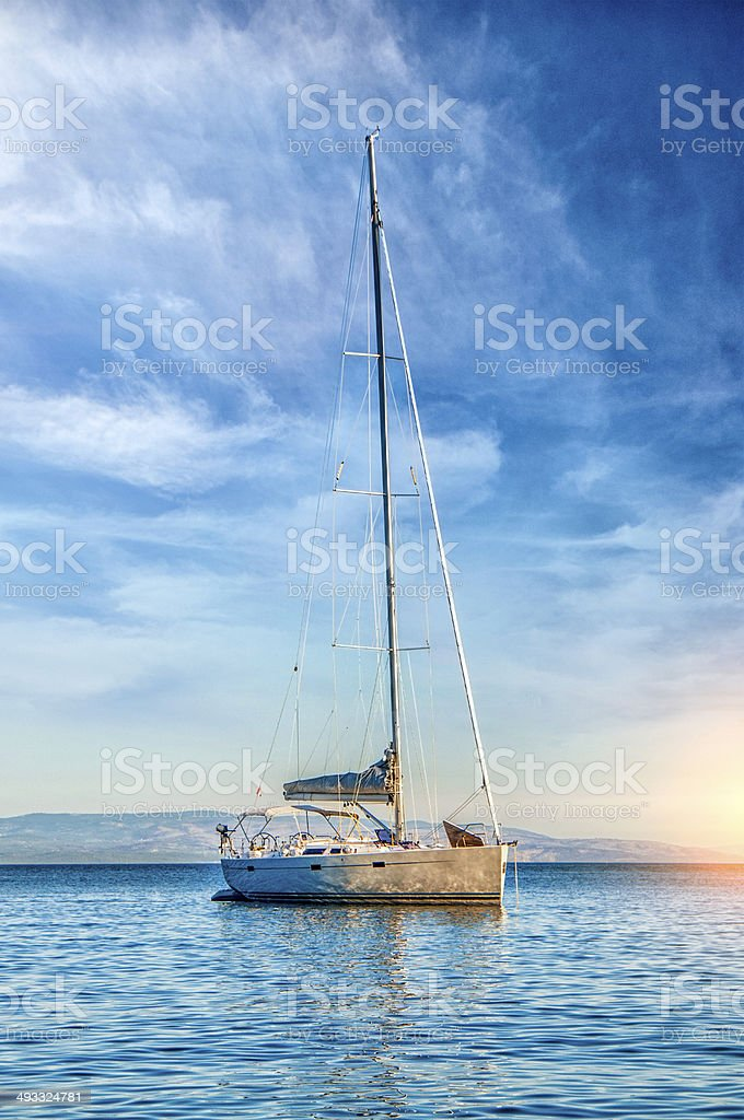 Sailing boat navigating over Adriatic sea at Sunset. Beautiful clear...
