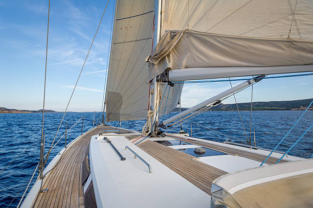 Sailing boat teak deck and hoisted sails, view from the – Foto