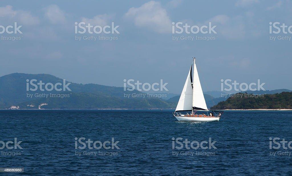 sailing boat tropical beach stock photo