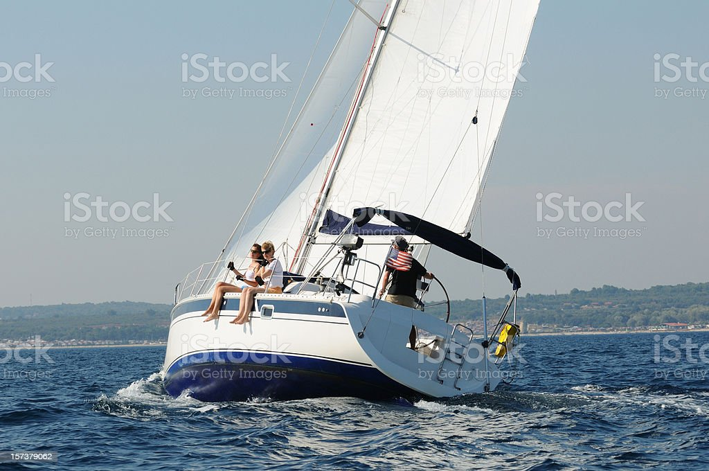 Sailing boat under white sails royalty-free stock photo