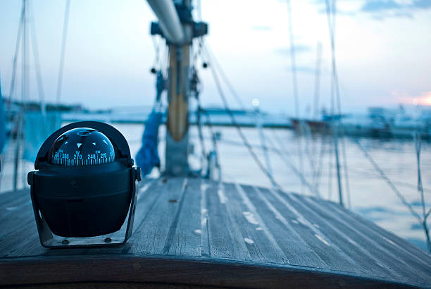 sailing boat with compass stock photo