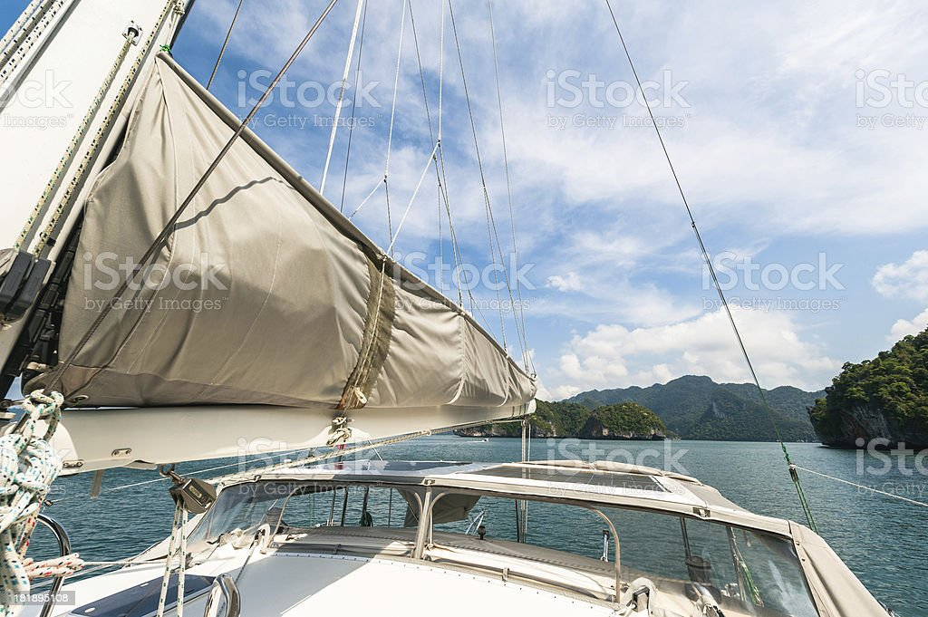 Sailing boat with view over beautiful bay royalty-free stock photo