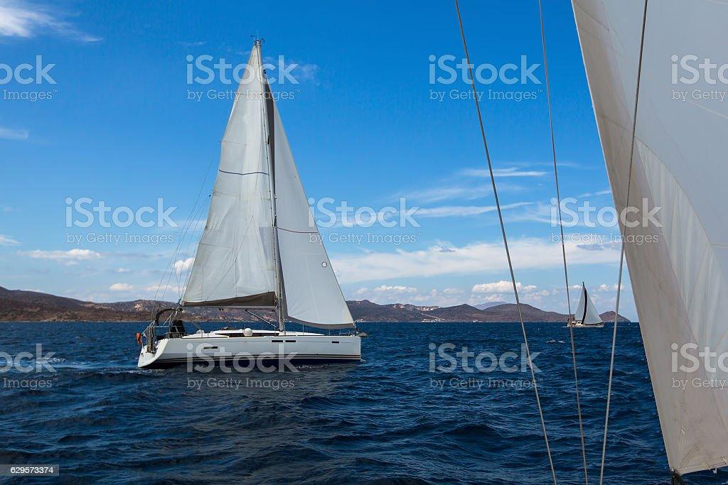 Sailing boats competitors of regatta. Yachting. stock photo