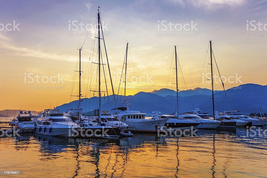 Sailing boats in marina at sunset. royalty-free stock photo