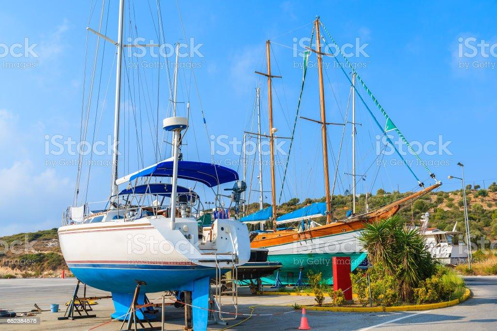 Sailing boats in shipyard of small Greek marina, Samos island, Greece stock photo