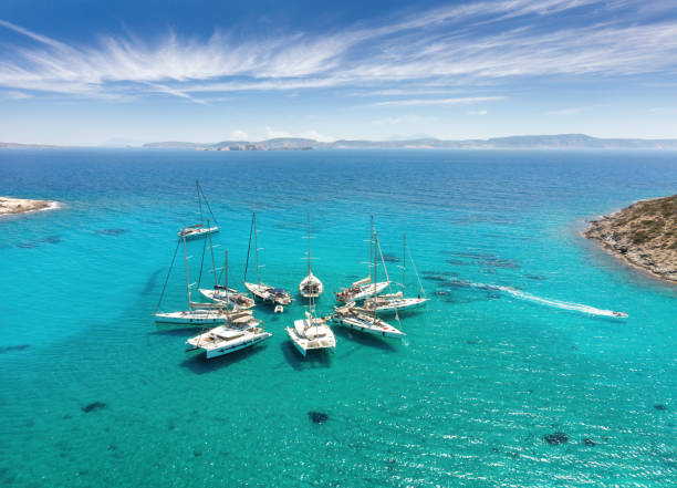 Sailing boats in star formation in Greece (Polyaigos, Cyclades) the largest uninhabited island of the Aegean Sea and one of the best and most beautiful sailing destinations stock photo