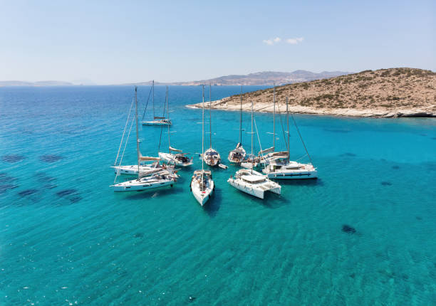 Sailing boats in star formation. Polyaigos is the largest uninhabited island of the Aegean Sea and one of the best and most beautiful sailing destinations. stock photo