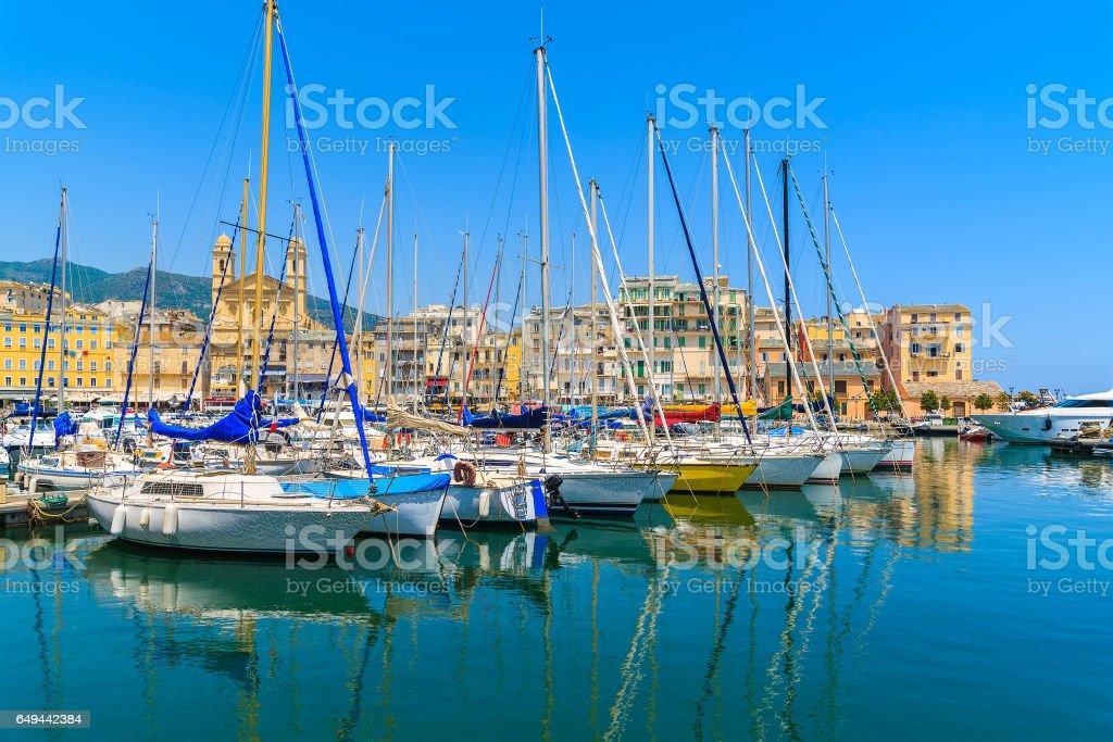 Sailing boats mooring in Bastia port on sunny summer day, Corsica island, France stock photo