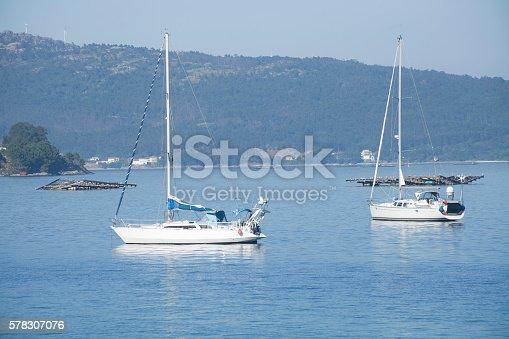Two sailing boats mooring near Muros, A Coruña province, Rías Baixas, Galicia, Spain.