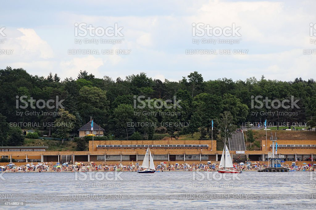 Sailing boats passing by Lido at the Wannsee lake stock photo